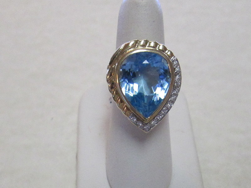 14 Karat Yellow Gold Blue Topaz and Diamond Ring  $1995