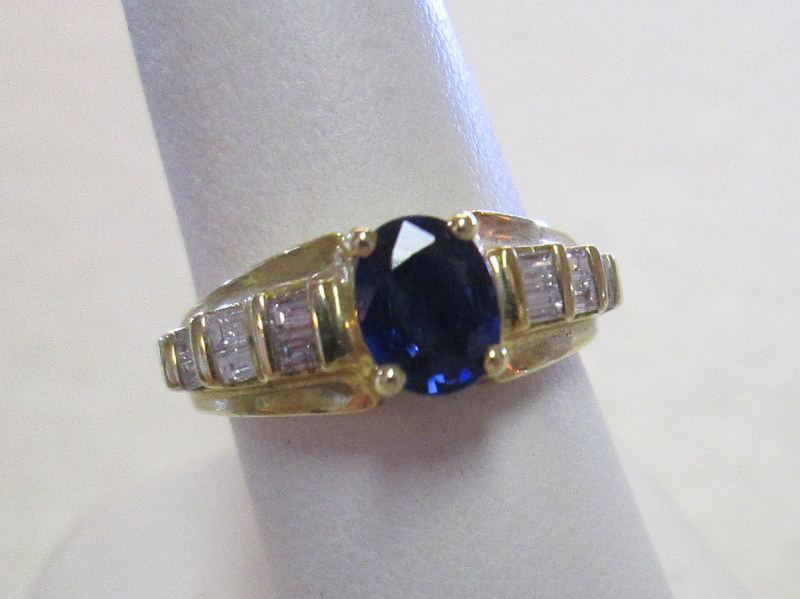 18 Karat Gold Blue Sapphire and Diamond Ring $3995