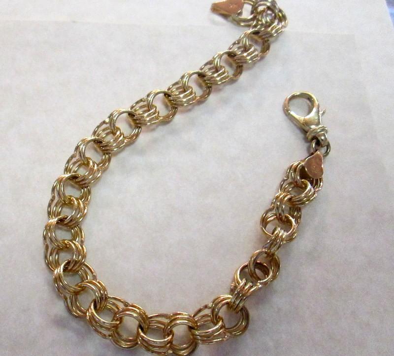 14 Karat Yellow Gold Charm Bracelet $2190