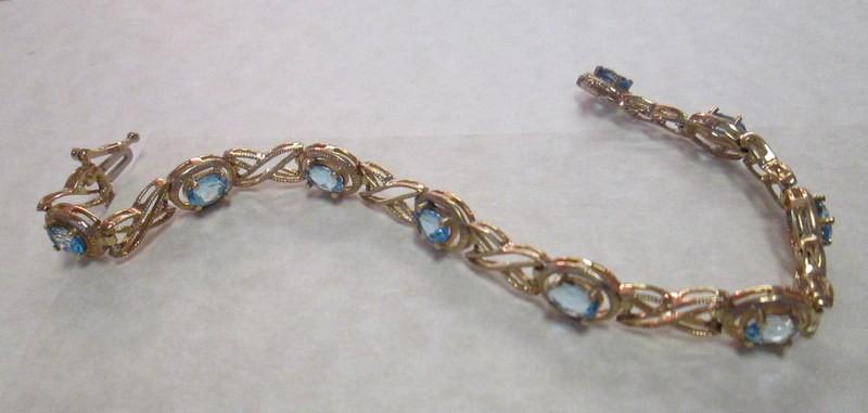 10 Karat Yellow Gold Blue Topaz Bracelet $1249